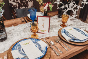 blue and amber table setting with silverware