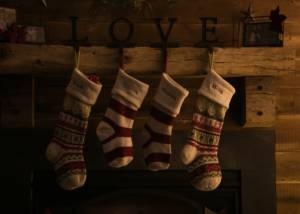 Stockings hung on a mantle by the letters L, O, V, E